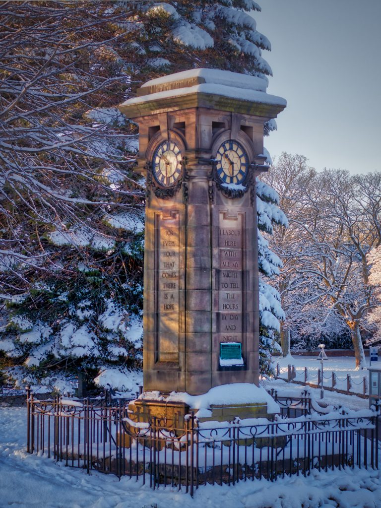 The Tettenhall clock tower in the centre of the village covered in snow